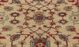 The cream central ground of this hand made carpet really shows the intricacy of the design.