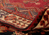 As is often found on handmade rugs, you can tell the difference between one and a machine made by the slight imperfections fo the pile and reverse side.