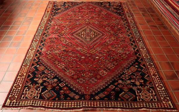 Featuring a central medallion, this Persian Qashaqi is suitable for many locations in a rural home.