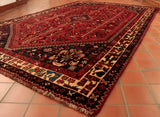 The carpet is probably 15 years or so old, the colour has softened and mellowed a little which makes it a very attractive piece.