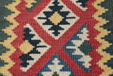 A flat weave kelim in bright colours can be used as a wallhanging.