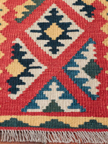 A multi coloured geometric Persian Qashqai kelim.