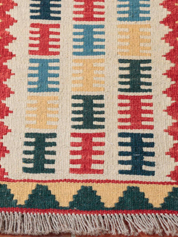 A small kilim measuring 61 x 42 centimetres