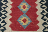 This small kilim could be used as a wall hanging or on a piece of furniture.