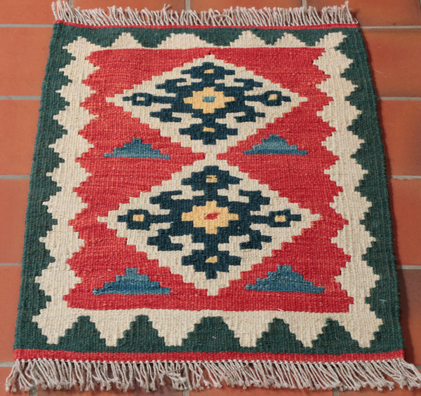 A small hand woven wool kilim with a couple of nice medallion patterns in the centre.