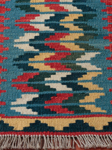 I love the bright colours in this unusual hand made kilim The woven fabric is made from wool which has been set  on a wool foundation.