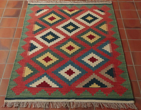 This is kelim woven by nomadic people in Iran. They will produce these and trade them when they next go into a town