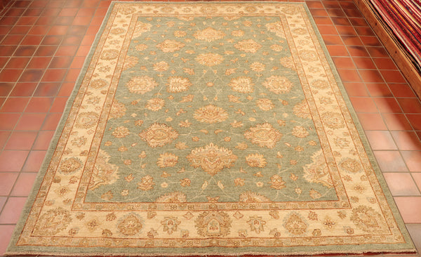A truly brilliant piece! This, handmade and naturally dyed, Afghan Ziegler features a soft duck-egg blue centre-ground that is masterfully complemented by the warm, golden-cream boarder and designs - and is contrasted largely by the copper toned accents featured throughout.