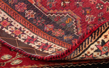 The back of the carpet masterfully illustrates how finely knotted this piece is for a tribal rug.