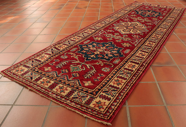 This exquisite Fine Afghan Kazak runner is 190 x 65cm (6'3 x 2'2) in size. Perfect for making an impression when walking into one's home.
