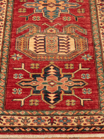 An excellent Afghan Kazak, finely hand-knotted using the naturally dyed wool of native Afghan sheep.