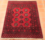 This Afghan Aqcha is far lighter tonally than one may typically find. Its rich crimson colour, found throughout the piece, is masterfully contrasted by the touches of blue-black and burgundy - whilst being complemented and brightened largely by the hints of cool beige that are present in the finer detailing.