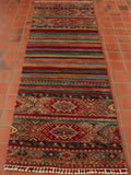 This finely hand-knotted Samarkand is a more unusual than most - as the Caucasian design is well dispersed throughout the rug, the stripes are very prominent in this piece and the pattern more intricate. the main colours are crimson, gold and a particularly soft sage green rarely seen in these pieces.