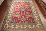 This Afghan Kazak has been commercially dyed, providing it with a rather strong sense of colour. This particular Kazak features a vibrant crimson red ground and edging that has been combined with cobalt and Carolina blue, fern green, soft grey, and warm cream aspects - resulting in a truly bright piece.