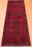 This Afghan Khal Mohammadi runner is truly excellent - with its rich scarlet ground being combined with the usual colours one may expect to find present in such a piece, such as deep blue-black, burnt orange, and beige features.