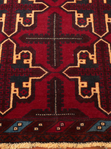 A handmade and naturally dyed Afghan Belouch rug.
