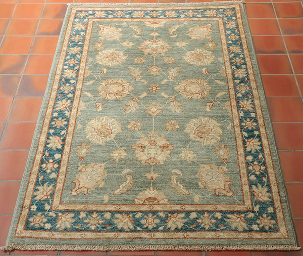 At 5 foot by 3 foot approximately, this Afghan Ziegler rug is ideal for the front of a fireplace.