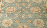 The central design is very floral, as is what is expected of Ziegler rugs.