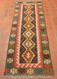 The terracotta colouring used in this runner works well on a terracotta background.