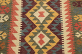 This kilim has been woven using stronger colours than usual.