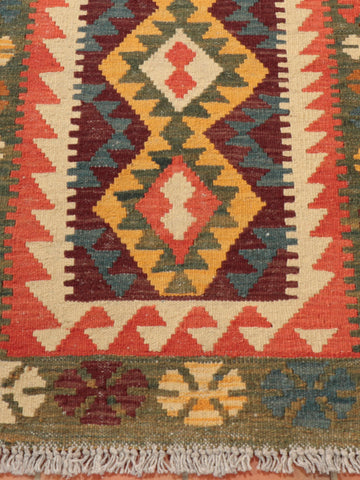 Dark green, terracotta, cream, blue, gold and brown/burgandy colouring have been used in this kilim runner.