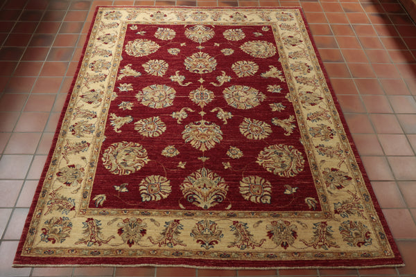 A wonderfully rich, scarlet ground Afghan Ziegler that has been combined with touches of cobalt blue, washed sage green, beige, and gold features - resulting in a truly wonderful piece.