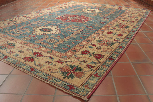 Afghan Kazak rugs use traditional Caucasian designs which a re centred around strong geometric patterns.