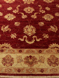 A handmade and naturally dyed, burgundy ground, Fine Afghan Ziegler rug.