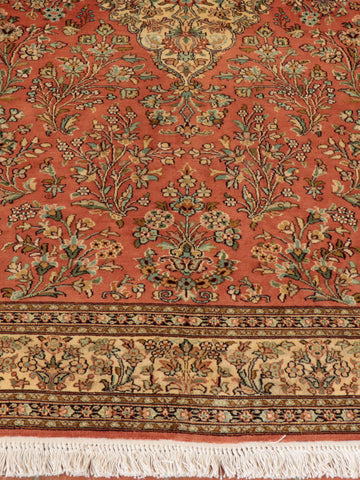 Wonderful terracotta ground Kashmir Silk rug.