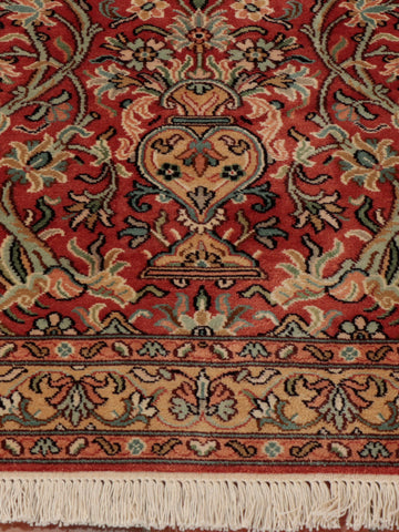 Tempting terracotta ground Kashmir Silk rug.