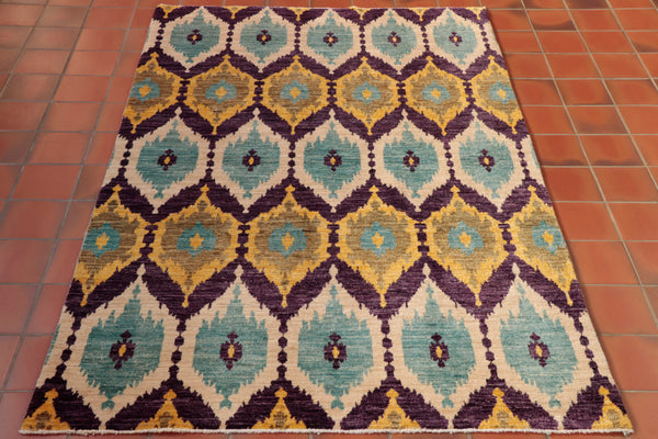 A lovely combination of unusual colours have been used in this Afghan rug.