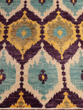 An unusual colour palette of purple, yellow, cream and duck egg blue has been used in this rug.
