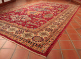 The main colours used in this rug are red, cream, gold, green and blue.