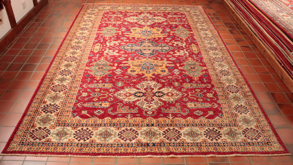 The pattern on this Afghan Kazak is influenced by old Caucasian designs.