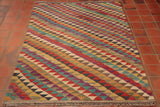 This kilim rug has a lovely range of colours, including, red, blue, green, yellow and purple