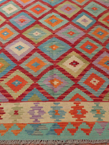What a wonderful design on this Afghan Kilim rug