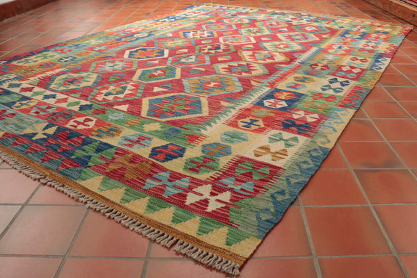 This Afghan Kilim is 242 x 175cm (7'11 x 5'9) in size