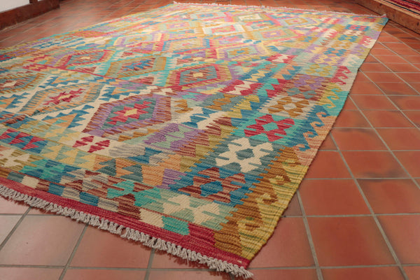 This particular Afghan Kilim carpet is 302 x 205cm (9'11 x 6'9) in size