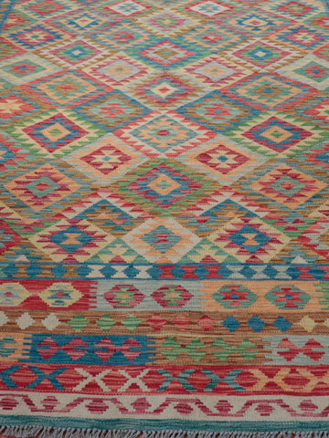 A very Large Afghan kilim carpet  which is 422cm by 310cm. lovely bright colours and lively border details