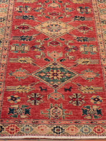This Afghan Kazak runner has a lovely orange/red main colouring