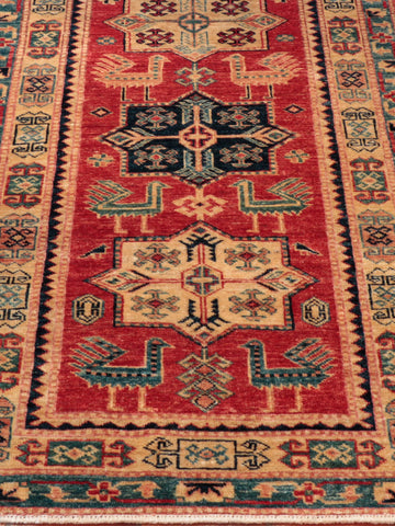 The Caucasian design is very traditional for Kazak rugs