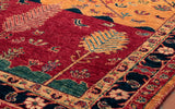 Not unlike Persian rugs, this Afghan Loribaft rug has traditional barber-pole edging to it