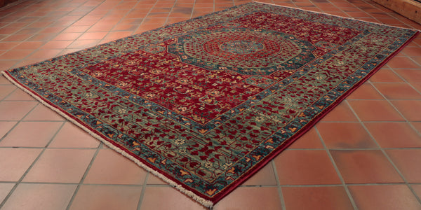 This Mamluk rug is roughly 6 foot by 4 foot, which is a perfect size for underneath or beside the hearth.