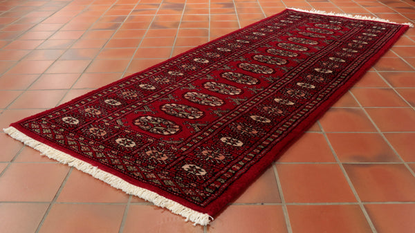 This Pakistan Bokhara runner is 185 x 62cm (6'1 x 2'1) in size