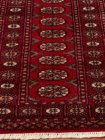 This red Bokhara runner is ideal for a sweeping hallway.