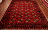 This has got to be one of the most popular designs in Oriental rugs. There are many variations of it but it is traditionally made in this sort of colour scheme. The background colour is a burnt orange red and the repeating lozenges have dark blue, cream, magenta and orange in them. This is made from vegetable dyed hand spun wool woven on to a cotton foundation.