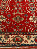 a good example of an inexpensive hand knotted Kazak rug from Afghanistan