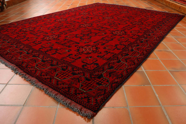A lovely hand knotted carpet, made from vegetable dyed wool with the red colouring being produced by boiling the root from the madder plant, which grows prolifically