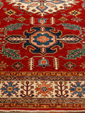 a traditional hand knotted carpet is lovely to own, it will last for many years and bring brightness to a dark space