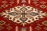 A cream central medallion makes a string statement when considering an Afghan Area rug.
